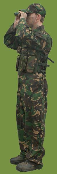 A Covert Combat Outdoor Lazertag Lazer Combat Player Looking Through Binoculars